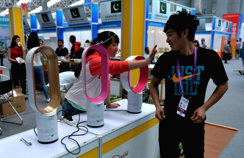 People visit the 2014 China (Kunshan) Import Expo in Kunshan, east China's Jiangsu Province, May 14, 2014. The 4-day expo kicked off Wednesday.  (Xinhua/Shen ...