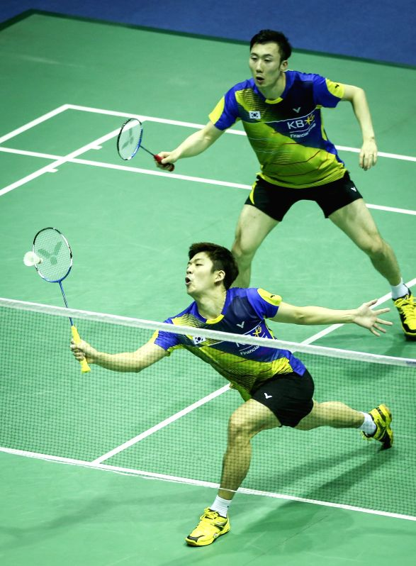 KUNSHAN, May 16, 2016 - Lee Yong Dae(Bottom) and Yoo Yeon Seong of South Korea return the shuttle during the men's doubles match against Marcus Ellis and Chris Langridge of England in the Group C ...