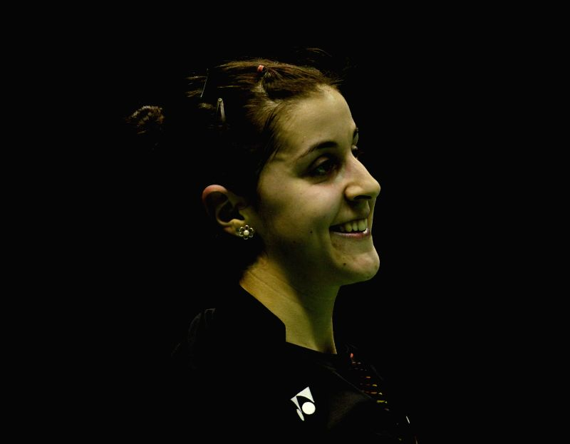 KUNSHAN, May 17, 2016 - Carolina Marin of Spain reacts during the women's singles match against Wang Shixian of China in the Group A match at the Uber Cup badminton championship in Kunshan, east ...