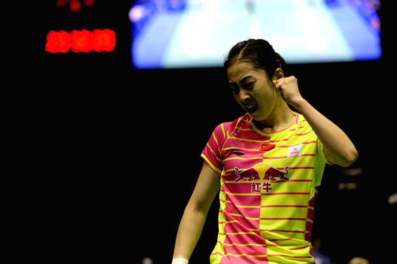 KUNSHAN, May 17, 2016 - Wang Shixian of China celebrates victory after the women's singles match against Carolina Marin of Spain in the Group A match at the Uber Cup badminton championship in ...