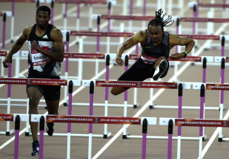 KUNSHAN, May 18, 2016 - Aries Merritt of the United States (R) competes during the men's 110m hurdles final at the 2016 IAAF World Challenge Beijing in Beijing, capital of China, May 18, 2016. Aries ...