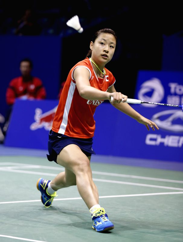 KUNSHAN, May 20, 2016 - Okuhara Nozomi of Japan competes during the women's singles match against Sung Ji Hyun of South Korea in the semifinal match at the Uber Cup badminton championship in Kunshan, ...