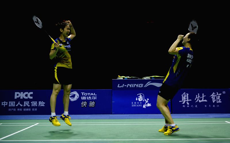 KUNSHAN, May 21, 2016 - Jung Kyung Eun (L) and Shin Seung Chan of South Korea celebrate after beating Tian Qing and Zhao Yunlei of China in the women's doubles match of the Uber Cup badminton ...