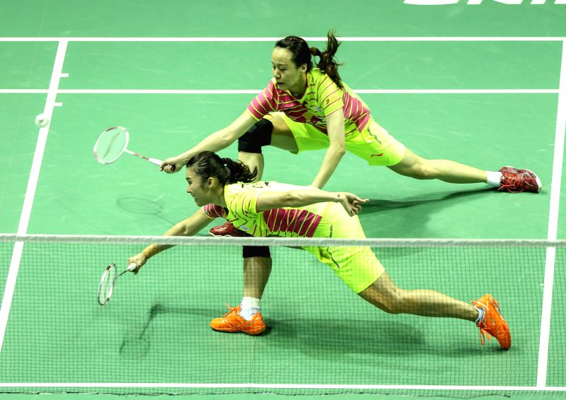 KUNSHAN, May 21, 2016 - Tian Qing (F) and Zhao Yunlei of China compete during the women's doubles match against Jung Kyung Eun and Shin Seung Chan of South Korea in the final match between China and ...