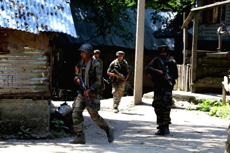 Kupwara : Security forces at the site of encounter with militants at Drugmulla near Kupwara in Kashmir on May 21, 2016.