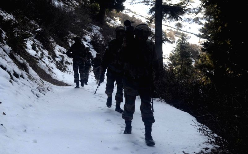 Soldiers at the site of encounter in Nowgam of Jammu and Kashmir's Kupwara district on Dec 2, 2014. Three militants were gunned down in the gun battle.