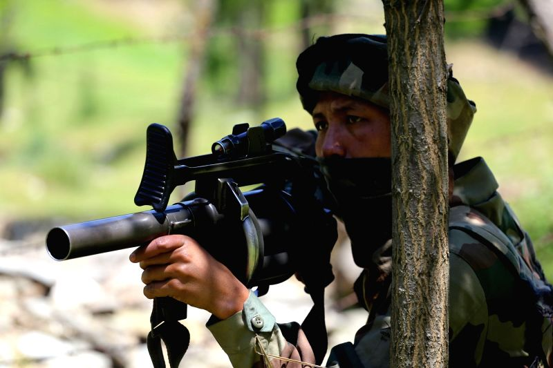 Kupwara : Soldiers take position during a gunfight with militants in north Kashmir's Kupwara district near the LoC on May 26, 2016.
