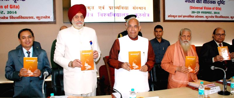 Haryana Governor Kaptan Singh Solanki during a national conference on Universal Vision of Bhagwad Gita at Kurukshetra University on Nov 28, 2014. Also seen Vice-Chancellor of the ... - Kaptan Singh Solanki