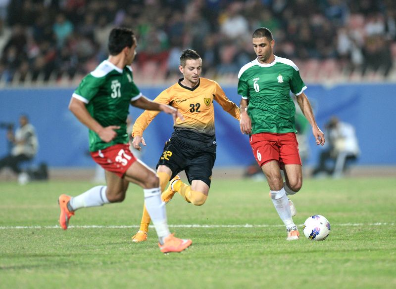 Ivan Nagaev (C) of Kuwait's Qadsia SC vies with Basem Fathi (R) of Jordan's Al wehdat SC during the AFC Champions leauge 2015 (Play Off) Football match in ...