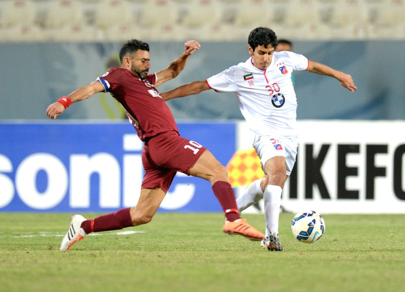 Talal al Motairi (R) of Kuwait's Al Kuwait SC vies with Abbas Atwi of  Lebanon's Nejmeh SC during their AFC CUP 2015 Football match in Kuwait City, Kuwait, on ...