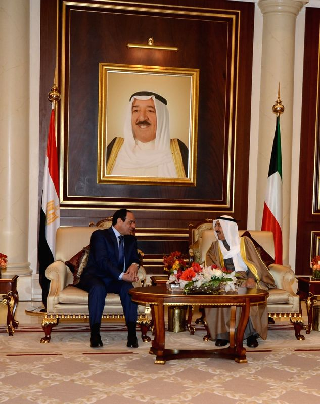 Visiting Egyptian President Abdel Fattah al-Sisi(L) speaks with the Emir of Kuwait, Sheikh Sabah al-Ahmad al-Jaber al-Sabah (R), during their meeting in Kuwait ..