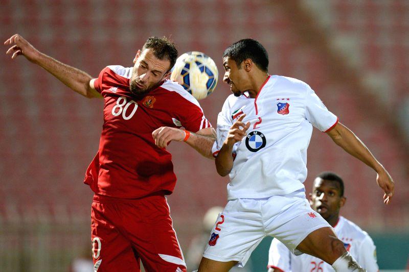 Abdulatef Salkeni (L) of Syria's Al Jaish vies with Sami Alsanea of Kuwait's Al Kuwait SC during their Group D match of AFC CUP 2015 in Kuwait City, Kuwait, on ...