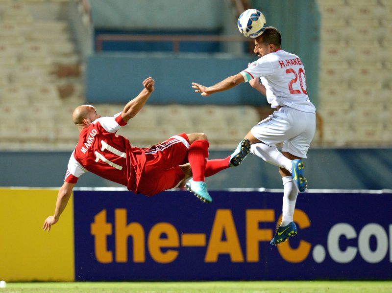 Mohamad Akkad (L) of Syria's Al Jaish vies with Husain Hakim of Kuwait's Al Kuwait SC during their Group D match of AFC CUP 2015 in Kuwait City, Kuwait, on March ...