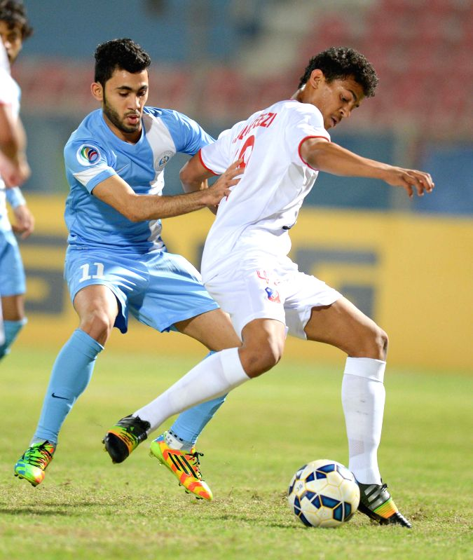Yousuf al Khebeezi (R) of Kuwait's Al Kuwait SC vies with Kimono Hasan of Bahrain's Riffa SC during their AFC CUP 2015 Football match in Kuwait City, Kuwait, ...