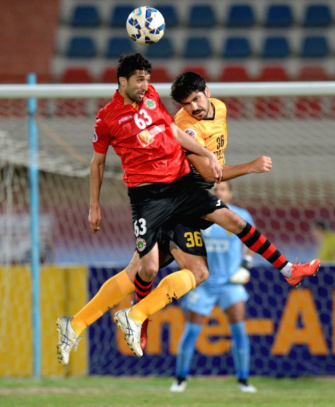 Dzhalilov Manuchehr (L) of Tajikistan's FC Istiklol vies with Khaled Ebrahim Hajiah of Kuwait's Qadsia SC during a Group C match at the AFC CUP 2015 in Kuwait ...