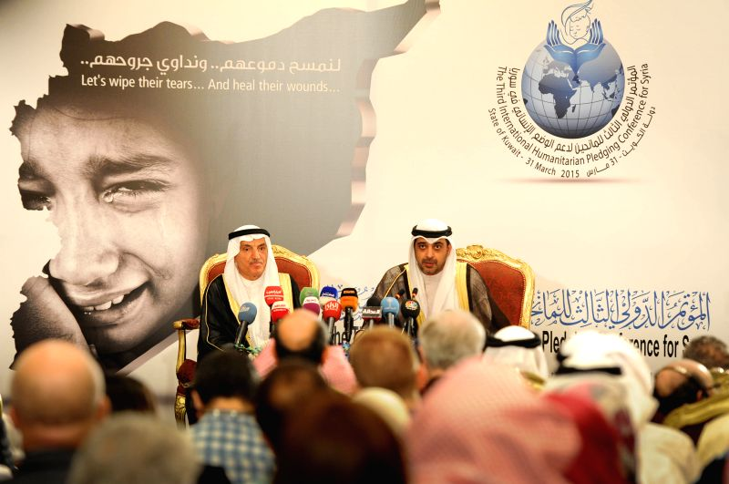 Kuwaiti Minister of State for Cabinet Affairs Sheikh Mohammad Abdullah Al-Mubarak Al-Sabah(R) speaks to the media during the press conference at the media ...