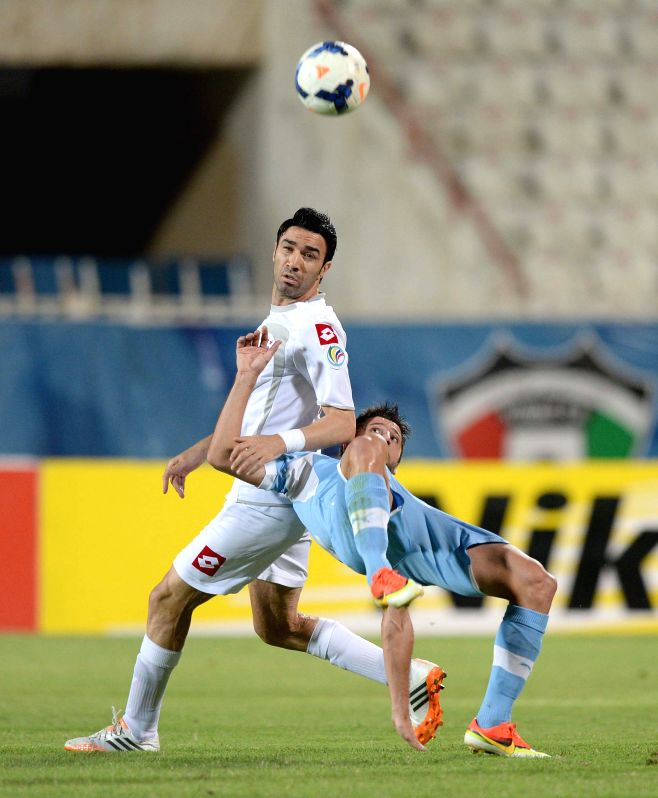 Javad Nekonam (L) of Kuwait's Al kuwait SC vies with Mladen Jovancic of Bahrain's Riffa SC during their 2014 AFC Cup football match in Kuwait City, on May 14, ...