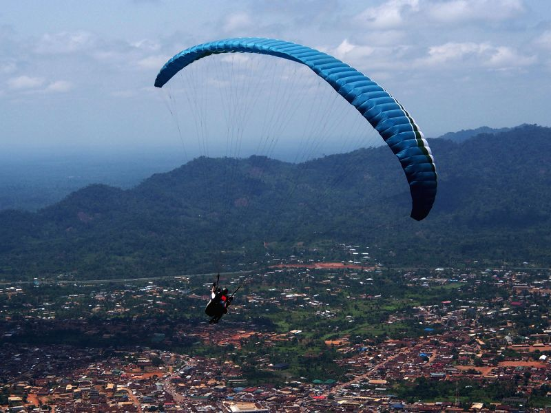 KWAHU (GHANA), April 18, 2014 A paraglider flies in the sky off from the edge of Kwahu Ridge in the Eastern Region of Ghana, during Ghana's Ninth Paragliding Festival, on April 18, 2014. .