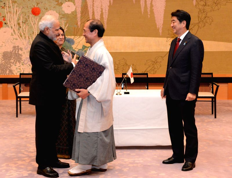 Indian Prime Minister Narendra Modi (1st L) shakes hands with Mayor of Kyoto Kadokawa Daisaku (2nd R) during a signing ceremony to establish sister city ties between . - Narendra Modi