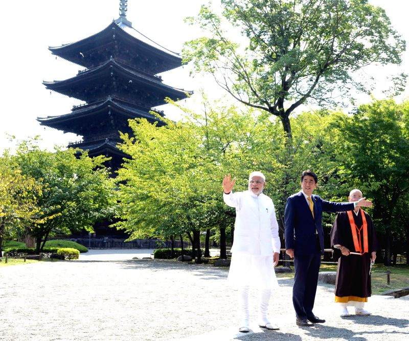 Indian Prime Minister Narendra Modi (1st L), accompanied by his Japanese counterparty Shinzo Abe (C), visits the Toji Temple in Kyoto Aug. 31, 2014. Modi started a ... - Narendra Modi