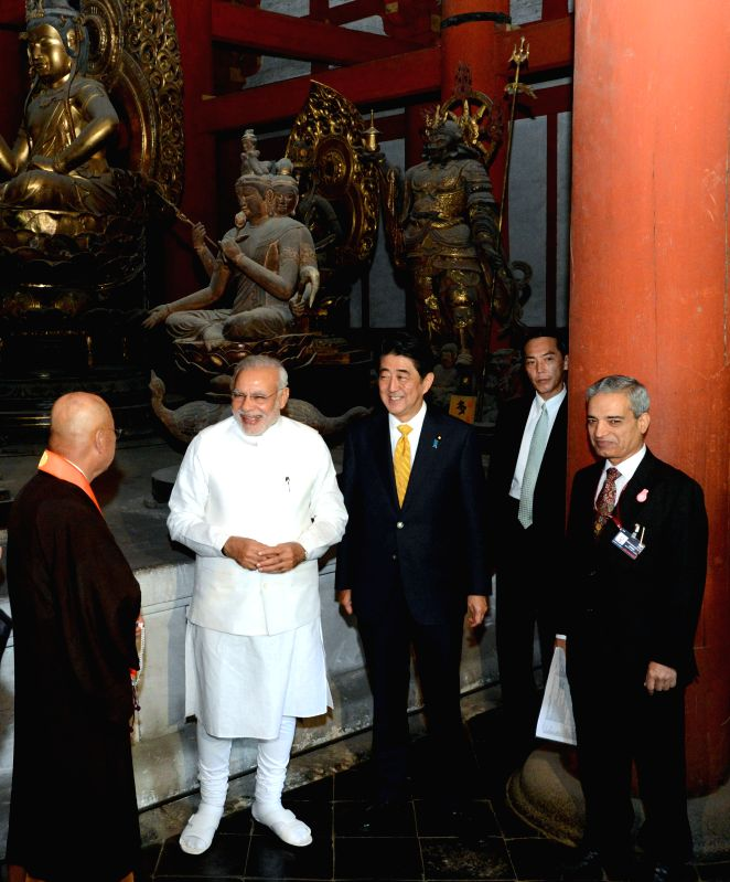 Indian Prime Minister Narendra Modi (2nd L), accompanied by his Japanese counterparty Shinzo Abe (C), visits the Toji Temple in Kyoto Aug. 31, 2014. Modi started a ... - Narendra Modi