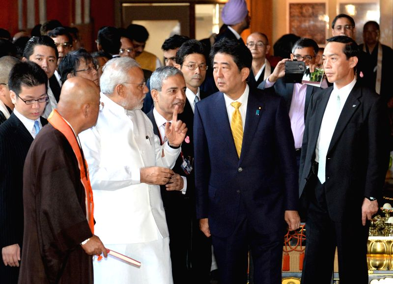 Indian Prime Minister Narendra Modi (2nd L Front), accompanied by his Japanese counterparty Shinzo Abe (2nd R), visits the Toji Temple in Kyoto Aug. 31, 2014. Modi ... - Narendra Modi