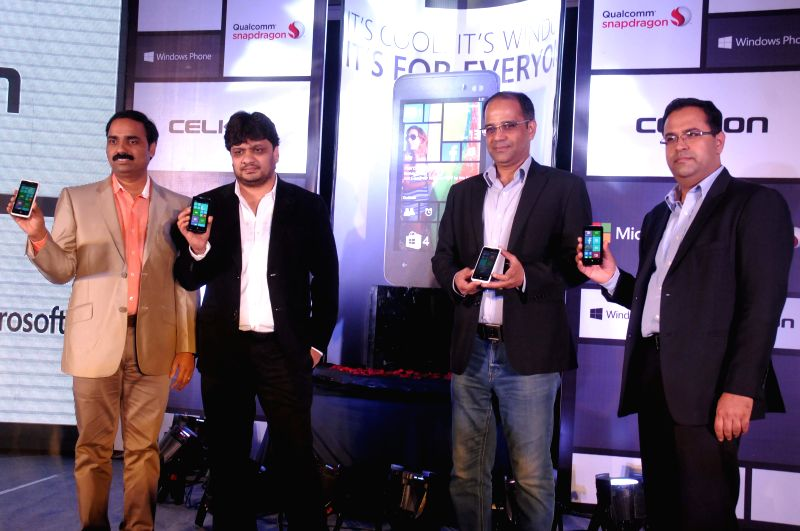 (L-R) Celkon Mobiles chief executive officer Y Guru, executive director Murali Retineni, Microsoft India director (mobility) Rajiv Ahlawat and Qualcomm India director (sales) Rohit Kapoor at the ... - Rohit Kapoor