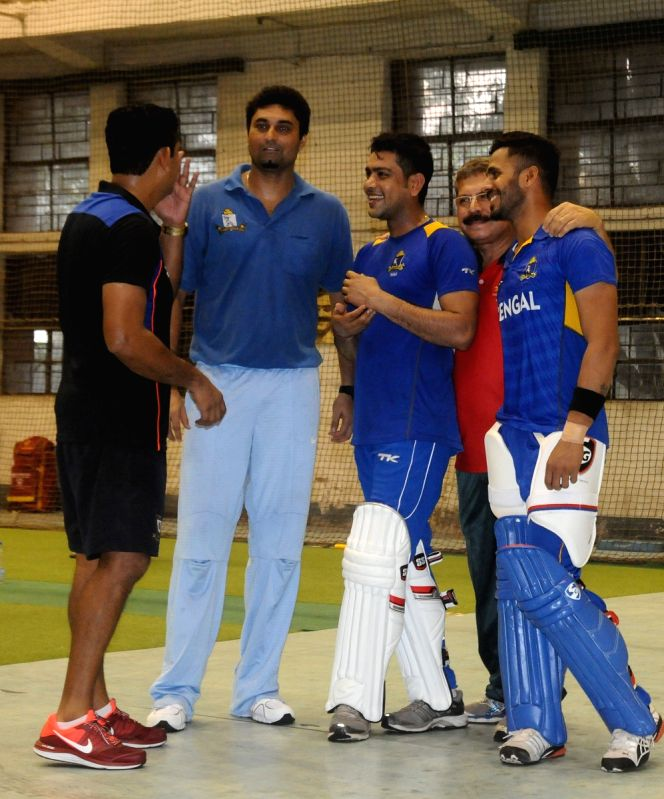(L-R) Cricketers Sairaj Bahutule, Laxmiratan Shukla and Manoj Tiwary with coach Ranadeb Bose at Pankaj Gupta Indoor Coaching Centre in Kolkata on Aug 17, 2015. - Ranadeb Bose