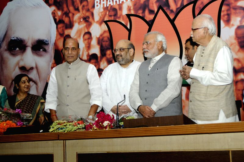 (L-R) External Affairs Minister Sushma Swaraj, Union Home Minister Rajnath Singh, new BJP chief Amit Shah, Prime Minister Narendra Modi, and BJP veteran L K Advani during a press conference organised - Sushma Swaraj, Narendra Modi, Rajnath Singh and L K Advani