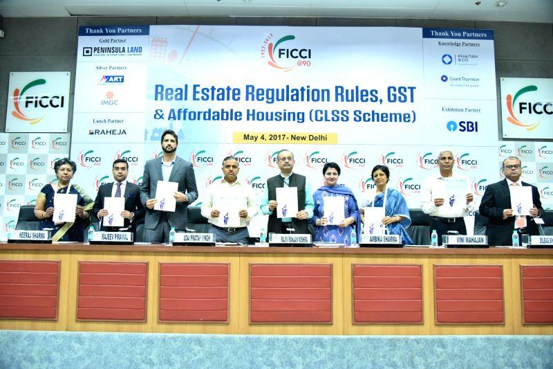 (L-R) Mousami Roy, Senior Director, FICCI; Neeraj Sharma, Director, Grant Thornton Advisory Pvt. Ltd.; Rajeev Piramal, Co-Chair, FICCI Real Estate Committee.; Udai Pratap Singh, Interim ... - Mousami Roy, Neeraj Sharma, Udai Pratap Singh, Rajiv Ranjan Mishra, Ambika Sharma, Vini Mahajan and Dilbag Singh Sihag