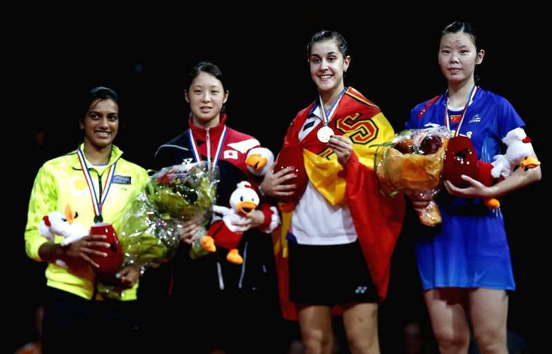 (L-R) PV Sindhu of India (bronze), Minatsu Mitani of Japan (bronze), Carolina Marin of Spain (gold) and Li Xuerui of China (silver) pose for a  the Women's Singles Final of 2014 BWF Badminton World ..