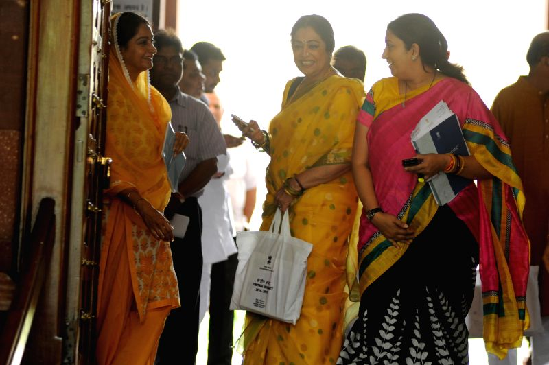 (L-R) Union Food Processing Minister Harsimrat Kaur Badal, veteran actress and BJP MP from Chandigarh Kirron Kher and Union HRD Minister Smriti Z Irani at the Parliament in New Delhi on July 10, ... - Harsimrat Kaur Badal, Chandigarh Kirron Kher and Smriti Z Irani