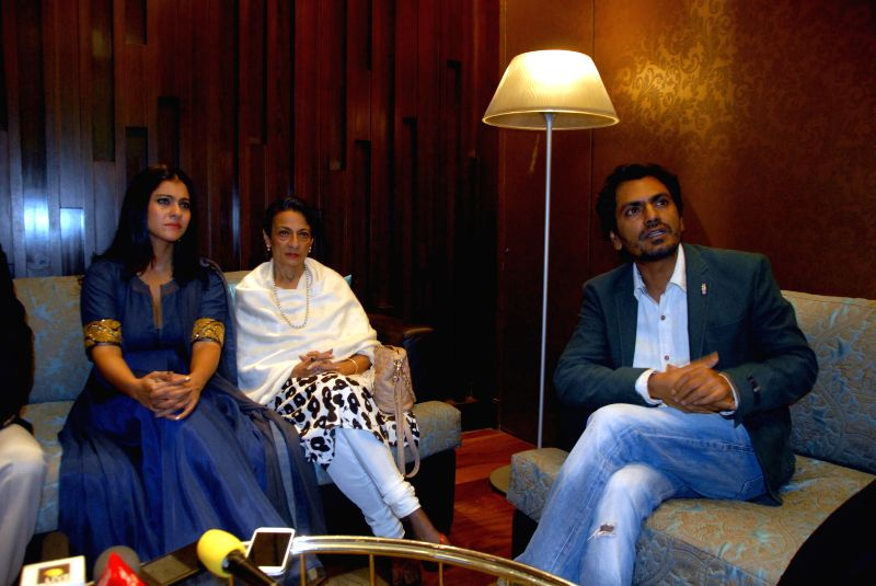 (L to R) Actors Kajol Devgan, Tanuja and Nawazuddin Siddiqui during a seminar organised by Prashanti Cancer Care Mission promoting `Breast Cancer Awareness` in Pune on July 24, 2014. - Tanuja and Nawazuddin Siddiqui