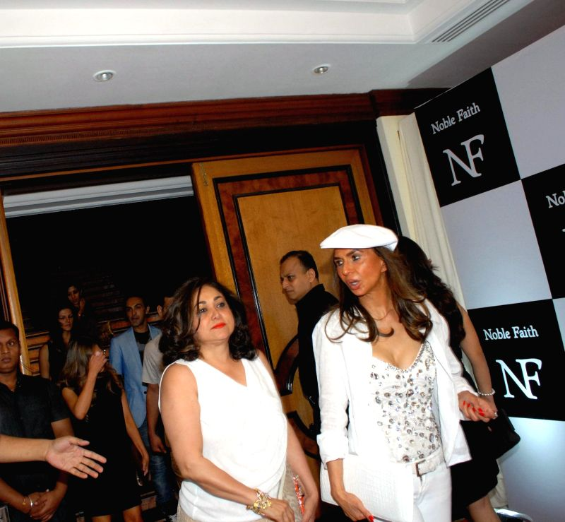 (L to R) Actress Tina Ambani and Socialite Parmeshwar Godrej during the launch of the brand Noble Faith in Mumbai on Aug 14, 2014. - Tina Ambani
