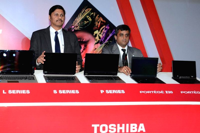 (L to R) Country Head - DS division, Toshiba India Sanjay Warke along with VP - Sales and Marketing - DS Division, Toshiba India Sivakumar launches the 2014 range of laptops in New Delhi on June 17, .