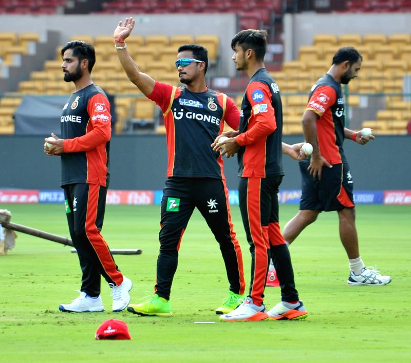 (L to R) Iqbal Abdulla and Pawan Negi of Royal Challengers Bangalore during a practice session at Chinnaswamy Stadium in Bengaluru on April 26, 2017.