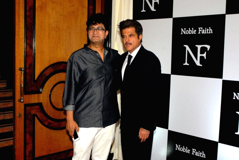 (L to R) Lyricist Prasoon Joshi and actor Anil Kapoor during the launch of the brand Noble Faith in Mumbai on Aug 14, 2014. - Anil Kapoor and Prasoon Joshi