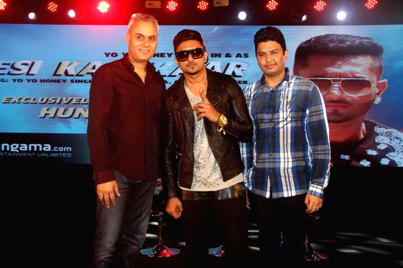 (L to R) MD, CEO of Hungama Digital Media Intertainment Neeraj Roy, singer Yo Yo Honey Singh and filmmaker Bhushan Kumar during the launch of new music album Desi Kalakaar in Mumbai on Aug. 26, 2014. - Singh and Bhushan Kumar