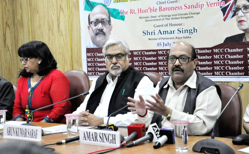 (L to R) Minister of the department Energy and Climate Baroness Sandip Verma, Vice president of Merchant Chamber of Commerce and Industry Arun Kumar and Rajya Sabha MP Amar Singh during interactive .. - Baroness Sandip Verma, Arun Kumar and Amar Singh