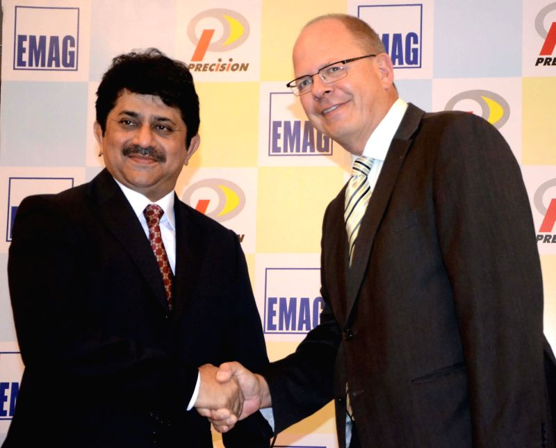 (L to R) Precision Camshafts Limited Chairman and Managing Director Yatin Shah and Dr  Andreas Mootz, Managing Director of the EMAG Automation during a press conference in Mumbai on June 19, 2014. - Yatin Shah