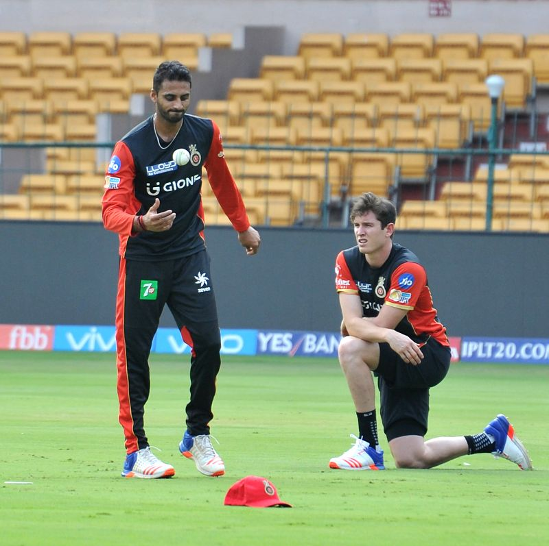 (L to R) Sreenath Aravind and Adam Milne of Royal Challengers Bangalore during a practice session at Chinnaswamy Stadium in Bengaluru on April 26, 2017.