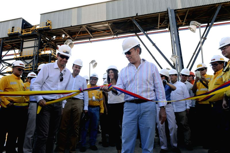 Image provided by Colombia's Presidency shows Colombian President Juan Manuel Santos (R, front) attending the opening ceremony of the extension of the dock of ...