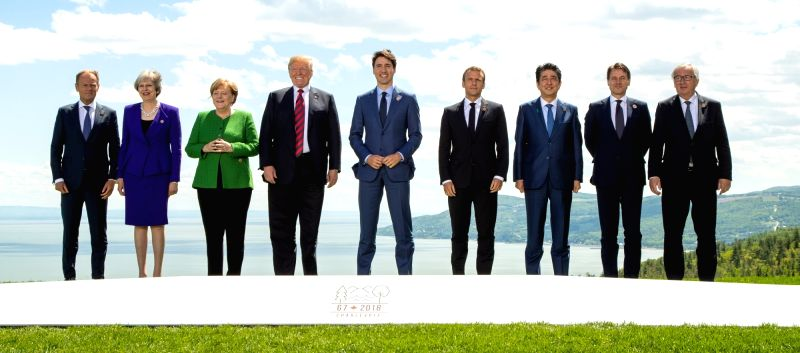 LA MALBAIE, June 8, 2018 - Participants of the Group of Seven (G7) summit European Union Council President Donald Tusk, British Prime Minister Theresa May, German Chancellor Angela Merkel, U.S. ... - Theresa May