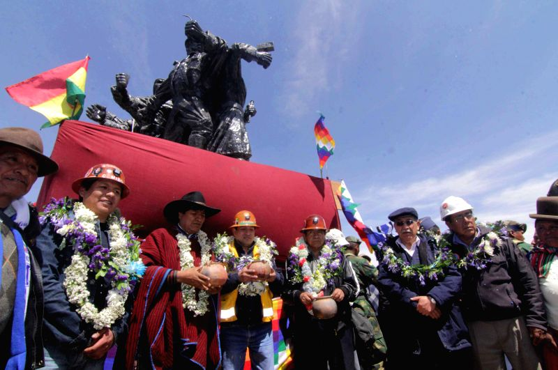 "Bolivian President Evo Morales (3rd, L) poses with workers in an event to commemorate the 28th anniversary of the denominated ""March for Life"", in ..."
