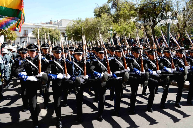 Soldiers take part in a parade to commemorate the 189th anniversary of Bolivia's independence at Murillo Square in La Paz, Bolivia, on Aug. 6, 2014. ...