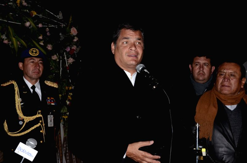 Ecuador's President Rafael Correa (C), delivers a speech upon his arrival at El Alto airport, in La Paz, Bolivia, during the early hours of Jan. 22, 2015. President .