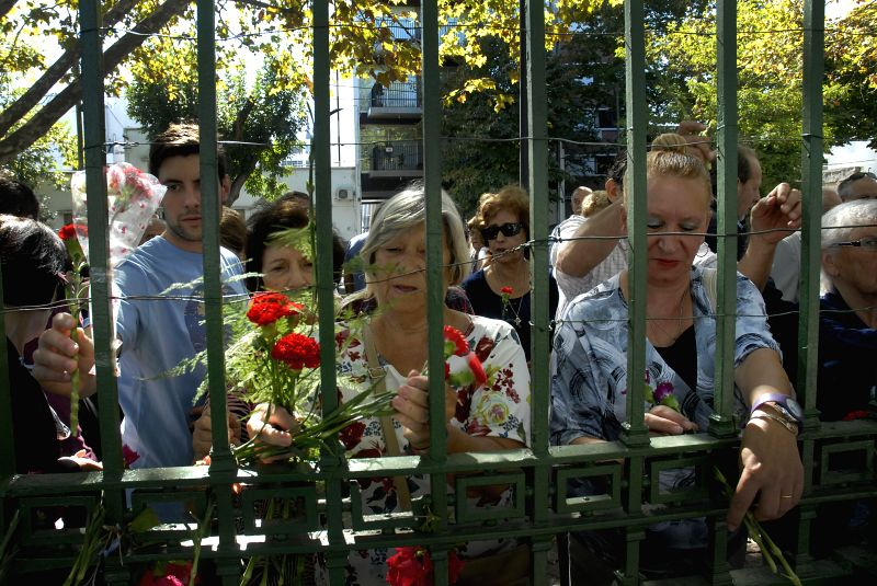"People put flowers in front of the former 7th Regiment during the event ""A neighbor, a flower"" to mark the 34th anniversary of the war between Argentina ..."