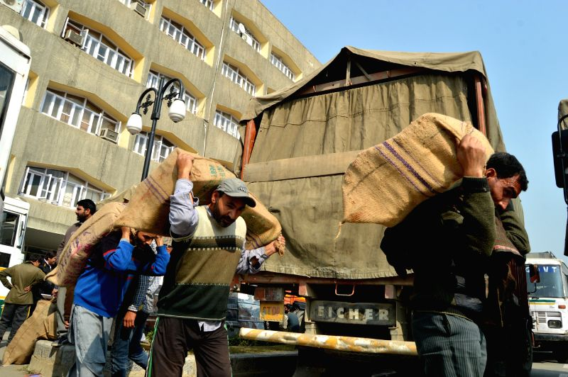 Laborers shift officials documents to winter capital Jammu for the upcoming winter session at Civil Secretariat, in Srinagar on Oct 31, 2015.