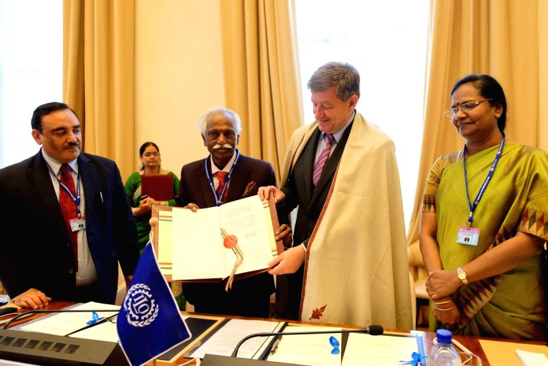 Labour Minister Bandaru Dattatreya presents International Labour Organisation Director-General Guy Ryder with the instruments of ratification for two global treaties against child labour and ... - Bandaru Dattatreya