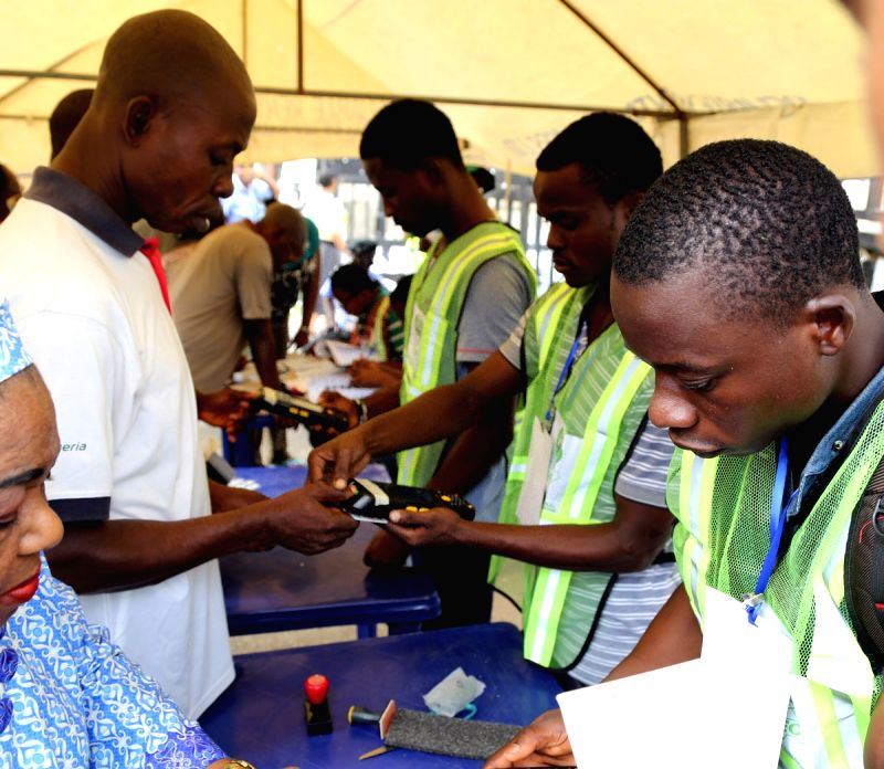 The Independent National Electoral Commision (INEC) officials register voters in Lagos, Nigeria, on March 28, 2015. Polling stations across Nigeria opened on ...